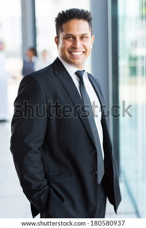 smart indian businessman in black suit - stock photo