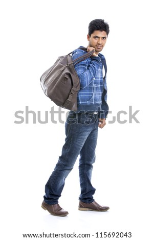 Smart Indian young man posing with travel bag on white. - stock photo