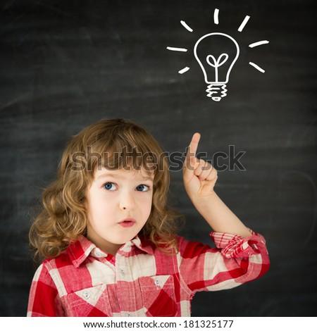 Smart kid in class. Idea concept - stock photo