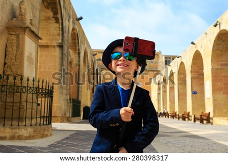 smart little boy taking selfie stick picture while travel in Europe, Malta - stock photo