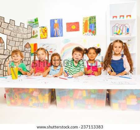Smart little kids learning letters and reading - stock photo
