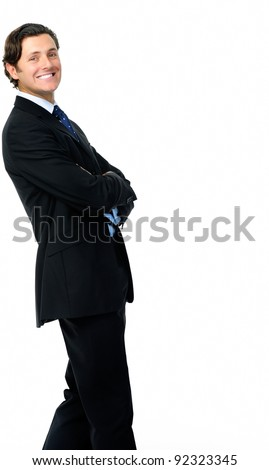 Smart looking businessman leans back in a relaxed stance - stock photo