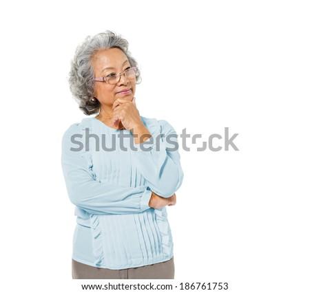 Smart Mature Asian Woman Thinking - stock photo