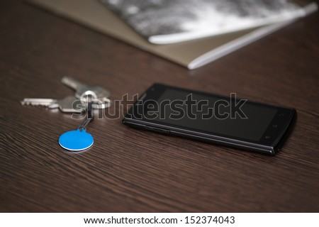 Smart phone and NFC tag on the table, NFC (Near Field Communication) theme - stock photo