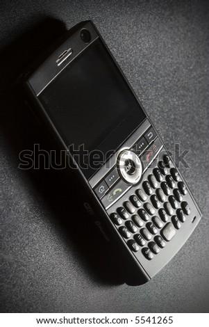 Smart-phone device, black elegant phone on black background - stock photo