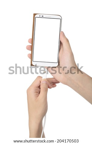 smart phone in case and charging cable on a hand - stock photo