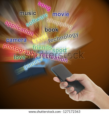 Smart phone in hand with text - stock photo