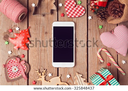 Smart phone mock up with rustic Christmas decorations for app presentation. View from above - stock photo