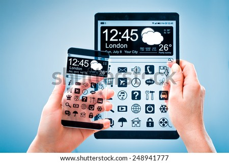Smart phone (phablet) and tablet with a transparent display in human hands. Concept actual future innovative ideas and best technologies humanity. - stock photo