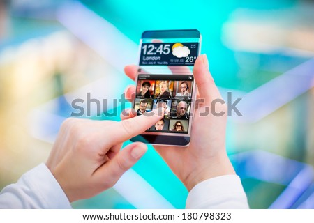 Smart phone (phablet) with a transparent display in human hands. Concept actual future innovative ideas and best technologies humanity. - stock photo