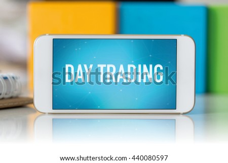 Smart phone which displaying Day Trading - stock photo