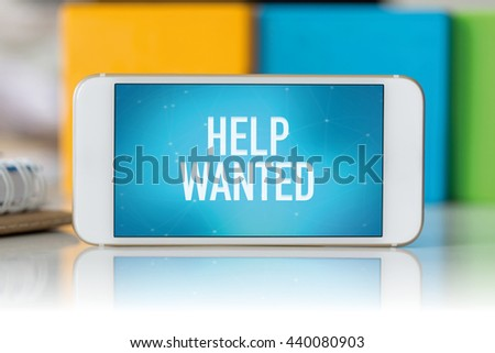 Smart phone which displaying Help Wanted - stock photo