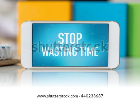 Smart phone which displaying Stop Wasting Time - stock photo