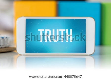 Smart phone which displaying Truth - stock photo