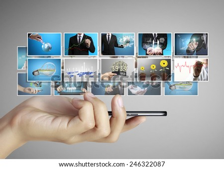 Smart phone with different photos coming - stock photo
