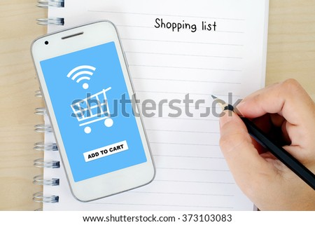 Smart phone with shopping online on screen and shopping list background, business and technology concept - stock photo