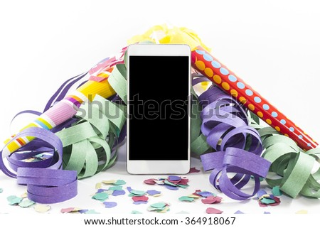 Smart phone with streamers, confetti and trumpets on white background - stock photo