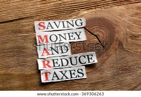 Smart -Saving Money And Reduce Taxes  acronym in business concept, - stock photo