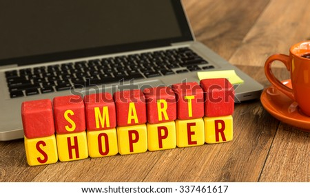 Smart Shopper written on a wooden cube in a office desk - stock photo