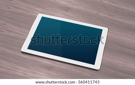Smart tablet on Wooden office table - stock photo