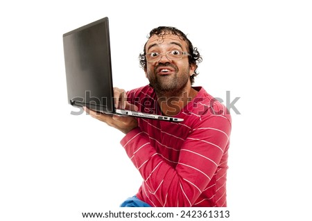 Smart Ugly man with glasses using a laptop - stock photo