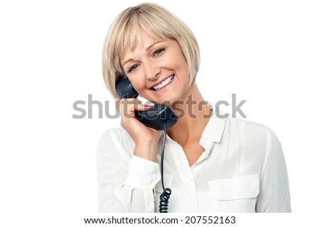 Smart woman secretary attending phone call  - stock photo