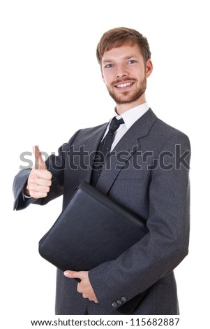 Smart young businessman with thumb up - stock photo