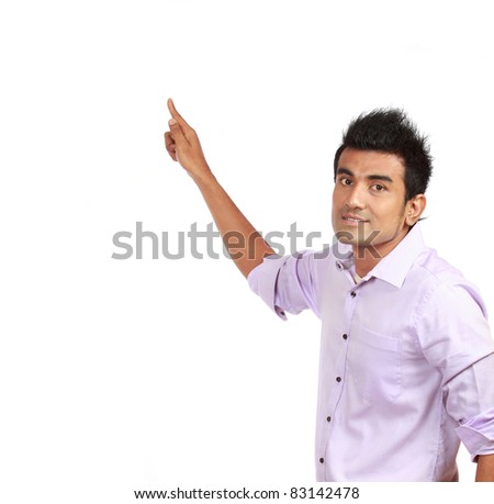 Smart young male business entrepreneur pointing at copyspace over white background - stock photo