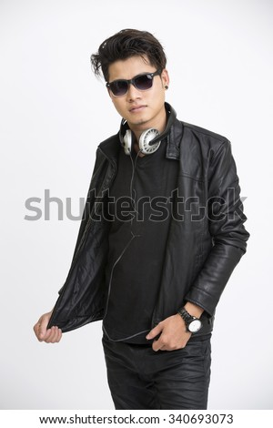 Smart young man in urban style with headphone and eye wear on white background. - stock photo