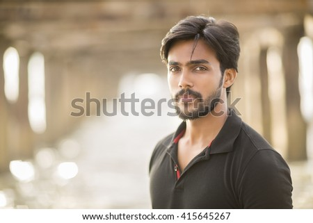 Smart young man portrait in outdoor backgraound. - stock photo