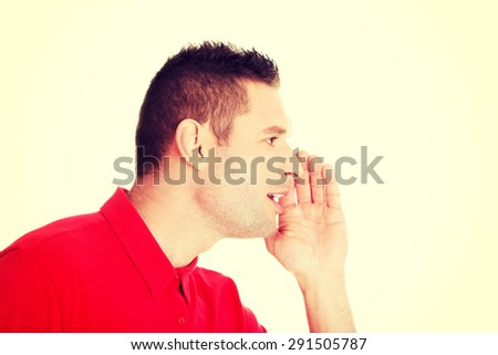 Smart young man telling some secrets - stock photo