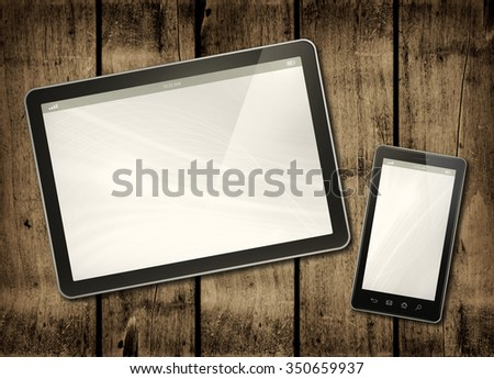 Smartphone and digital tablet PC on a dark wood table - horizontal office mockup - stock photo