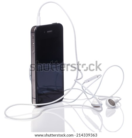 Smartphone and earphones over white background - stock photo