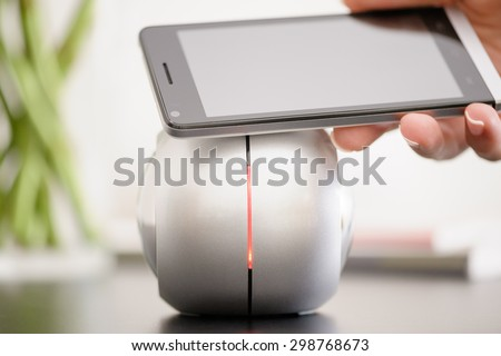 Smartphone and NFC speaker, NFC (Near Field Communication) theme - stock photo