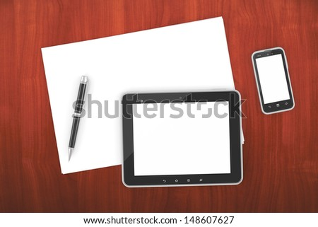 smartphone and tablet PC on a table with a blank screen - stock photo