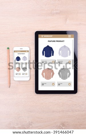 Smartphone and tablet with ecommerce website screen - stock photo
