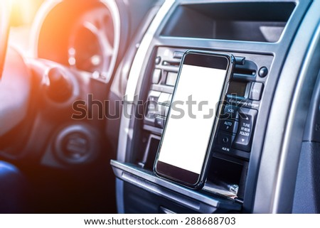 Smartphone are putting on the radio in a car. - stock photo