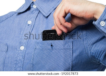 Smartphone in a pocket of shirt - stock photo