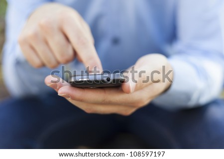 Smartphone in hands - stock photo