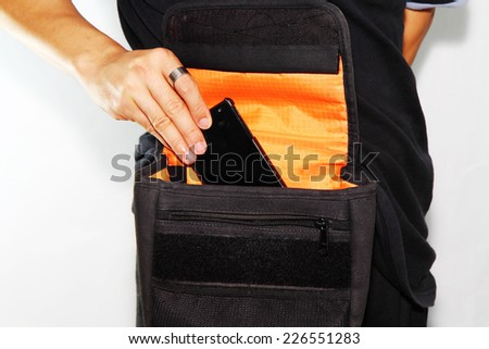 smartphone in the bag - stock photo