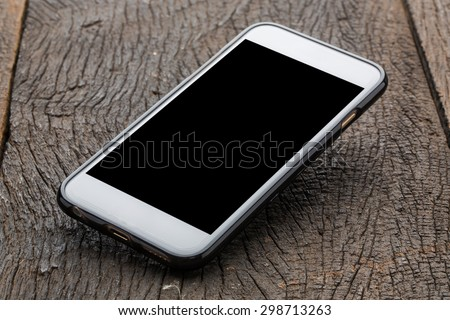 Smartphone on wood background.  - stock photo