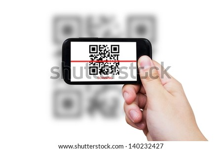 Smartphone scanning QR code - stock photo