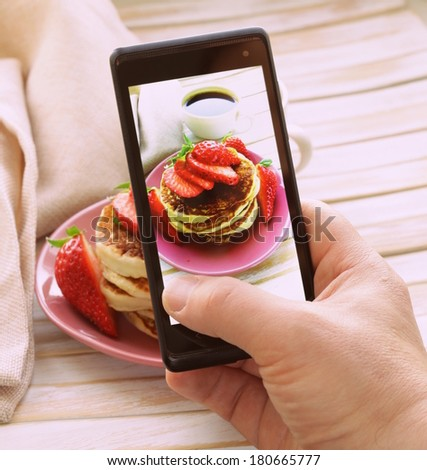 smartphone shot food photo  - pancakes for breakfast with fresh strawberries - stock photo
