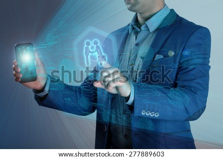 Smartphone shows a virtual screen with a projection of a business transaction - stock photo