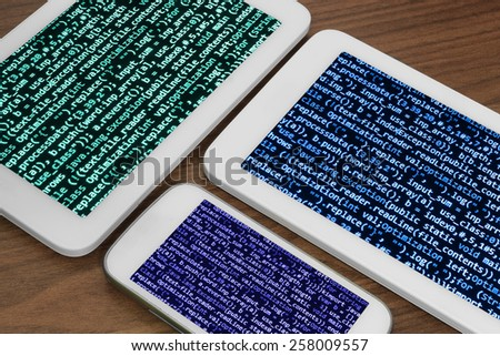 Smartphone tablet app developer screen. Office deviece on wooden desk. Digital technology background. Programming code abstract screen of software developer. Computer script, function. - stock photo
