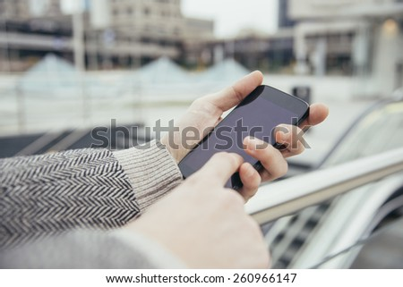 smartphone texting urban man - stock photo