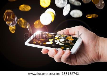 Smartphone to make money - stock photo