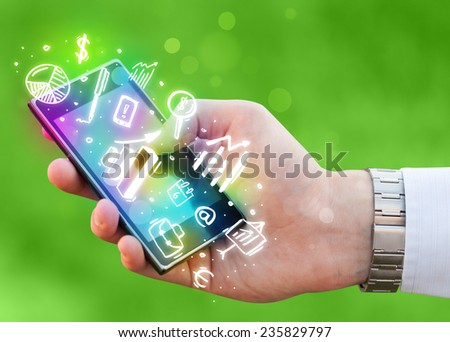 Smartphone with finance and market icons and symbols concept - stock photo