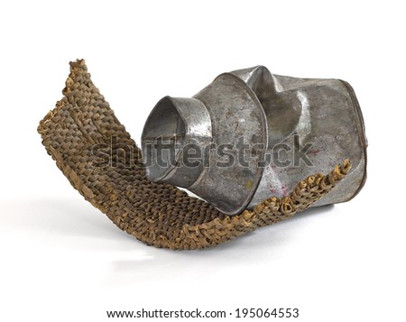 Smashed, damaged, cracked tin canister, bucket, teapot and willow bag, basket - the still life compositions form old used household items in Provence stile. - stock photo