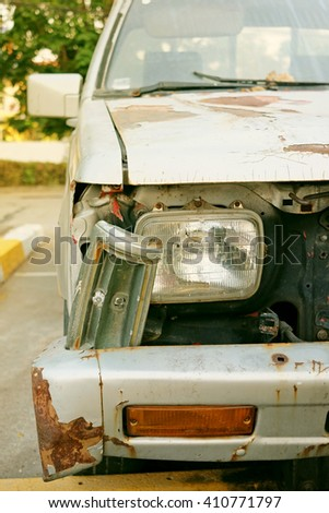 smashed old dirty car light exterior in vintage style - stock photo